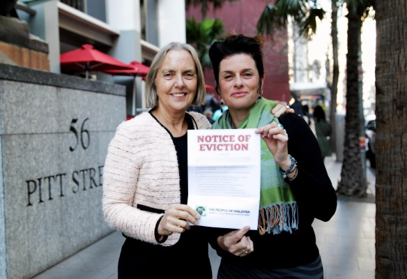 Greens Senator Lee Rhiannon (left) and Natalie Lowry (right) flash an eviction notice for Lynas in Sydney. (Photo: Supplied)