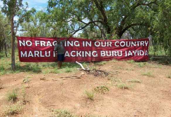 Protestors hang the banner to stop Buru Energy from fracking. (Photo: Supplied)
